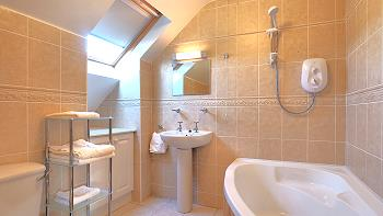 Bathroom with shower over tub