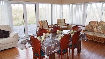 Dining table, more comfortable seating options at rear
