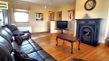 Comfortable leather suite & open fire place